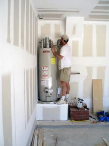 Sam, one of our Gilroy water heater repair experts is investigating a broken unit